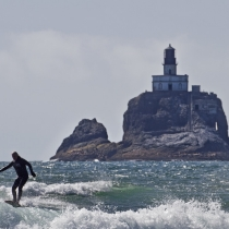 Tillamook Lighthouse and surfer