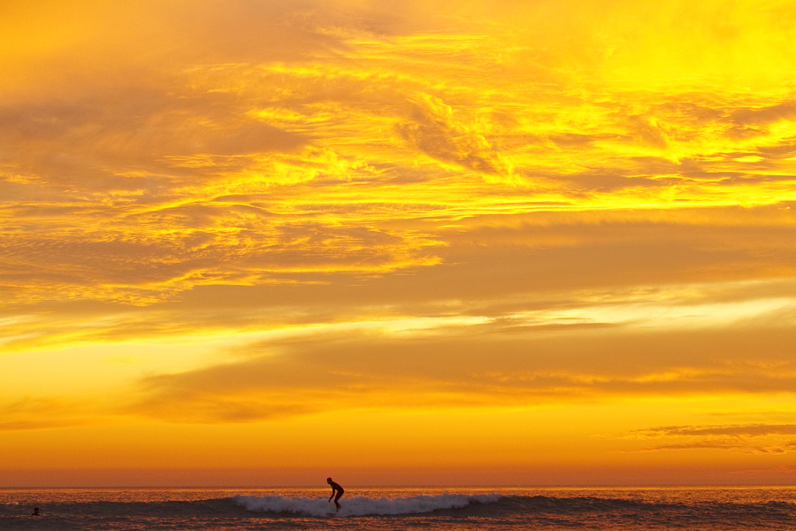 Amazing sunset and surfer