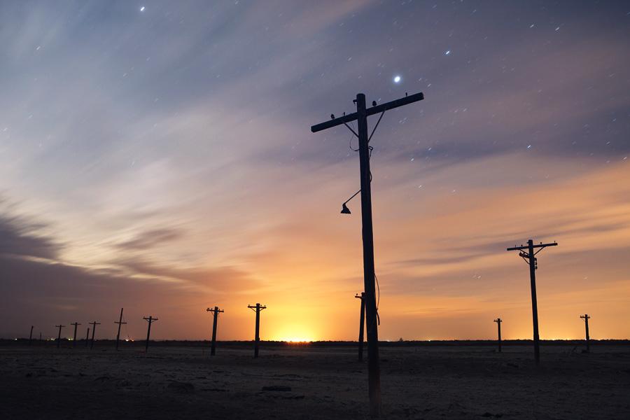 Salton Sea at Night with Telephone Poles